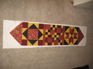 Front of table runner attached to batting.