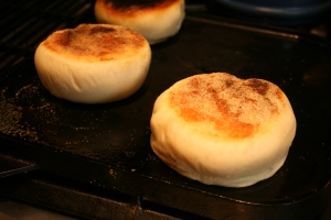 English muffins flipped on the griddle